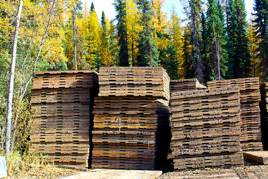 Piles of access mats used to build temporary roads